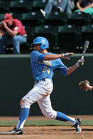 Brian Carroll #24 of the UCLA Bruins bats against the Washington State Cougars at Jackie Robinson Stadium on March 24, 2012 in Los Angeles,California. UCLA defeated Washington 12-3.(Larry Goren/Four Seam Images)