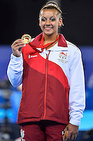 Rebecca Downie of GBR pose with gold medal won in uneven bars during Commonwealth Games artistic gymnastics, Thursday, July 31, 2014 in Glasgow, United Kingdom. (Mo Khursheed/TFV Media via AP Images)