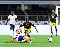 DALLAS, TX - JULY 25: Sebastian LLetget #17 of the United States strips the ball from Bobby Reid #10 of Jamaica during a game between Jamaica and USMNT at AT&T Stadium on July 25, 2021 in Dallas, Texas.