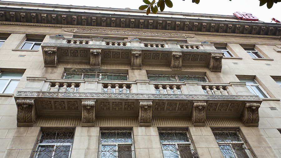 Looking Up At The Balconies Exemplifies The Intricate Decorative Detail On The Building In Hankou (Hankow).