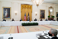 United States President Joe Biden holds a Cabinet Meeting in the East Room of the White House in Washington D.C. on Thursday, April 1, 2021.  President Biden announced that he is asking five cabinet members to explain his jobs plan to the American public.  From left to right: US Secretary of Health and Human Services Xavier Becerra; US Secretary of the Interior Debra Haaland; US Secretary of State Antony Blinken; President Biden; US Secretary of Defense Lloyd J. Austin III; US Secretary of Commerce Gina Raimondo; US Secretary of Transportation Pete Buttigieg; US Secretary of Homeland Security Alejandro Mayorkas; and US Trade Representative (USTR) Katherine Tai.  Pictured in the lower right foreground is US Attorney General Merrick Garland.<br /> CAP/MPI/RS<br /> ©RS/MPI/Capital Pictures