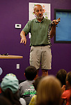 Gabe Kerschner, with Conservation Ambassadors, talks about Steve, a Morelet's crocodile during a special presentation at the Boys & Girls Club of Western Nevada in Carson City, Nev., on Tuesday, June 12, 2018. The program, which also includes an evening show at the library, is part of the Carson City Library's Summer Learning Challenge. <br /> Photo by Cathleen Allison/Nevada Momentum