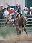 Bull riding action during the Smackdown Tour at Fuji Park in Carson City, Nev., on Saturday, June 7, 2014.<br /> Photo by Cathleen Allison