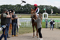 17th May 2020, Cologne, Nordrhein-Westfalen, Germany;  Jockey Clement Lecoeuvre is interviewed by a television team after winning the black gold race with No Limit Credit