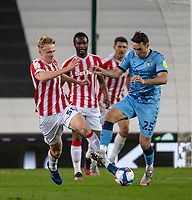 21st April 2021; Bet365 Stadium, Stoke, Staffordshire, England; English Football League Championship Football, Stoke City versus Coventry; Matty James of Coventry City is tackled by Connor Taylor of Stoke City