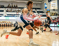 WASHINGTON, DC - JANUARY 29: Jamison Battle #10 of George Washington on the attack during a game between Davidson and George Wshington at Charles E Smith Center on January 29, 2020 in Washington, DC.