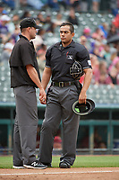 Umpires Kyle Wallace and Jose Matamoros during a Texas League game between the Midland RockHounds and Frisco RoughRiders on May 21, 2019 at Dr Pepper Ballpark in Frisco, Texas.  (Mike Augustin/Four Seam Images)
