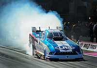 Oct. 30, 2011; Las Vegas, NV, USA: NHRA funny car driver Tim Wilkerson during the Big O Tires Nationals at The Strip at Las Vegas Motor Speedway. Mandatory Credit: Mark J. Rebilas-
