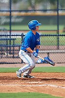 GCL Blue Jays third baseman Davis Schneider (76) follows through on a swing during the first game of a doubleheader against the GCL Yankees East on July 24, 2017 at the Yankees Minor League Complex in Tampa, Florida.  GCL Blue Jays defeated the GCL Yankees East 6-3 in a game that originally started on July 8th.  (Mike Janes/Four Seam Images)