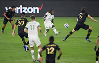 LOS ANGELES, CA - SEPTEMBER 13: Yimmi Chara #23 of the Portland Timbers sends over a ball during a game between Portland Timbers and Los Angeles FC at Banc of California stadium on September 13, 2020 in Los Angeles, California.