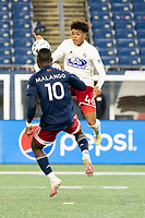 FOXBOROUGH, MA - OCTOBER 16: Mayele Malango #10 of New England Revolution II and Justin Che #46 of North Texas SC compete for a high ball during a game between North Texas SC and New England Revolution II at Gillette Stadium on October 16, 2020 in Foxborough, Massachusetts.