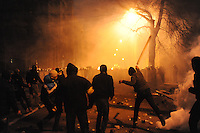 Clashes between the protesters and the Riot police (Bekrut) defending the Kiev city council building.The prostest was ignited by  the Ukrainian  government's decision to stall on a deal that would bring closer ties with the European Union.