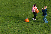 MR / Schenectady, NY. Boy (6) claps as girl (6, African-American) carries pumpkin. MR: Joh18, Lus1. ID: AK-ICP. © Ellen B. Senisi