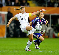 Christie Rampone, Karina Maruyama.  Japan won the FIFA Women's World Cup on penalty kicks after tying the United States, 2-2, in extra time at FIFA Women's World Cup Stadium in Frankfurt Germany.