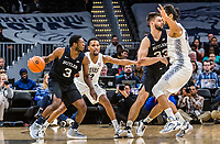 WASHINGTON, DC - JANUARY 28: Terrell Allen #12 and Omer Yurtseven #44 of Georgetown defend gainst Kamar Baldwin #3 of Butler during a game between Butler and Georgetown at Capital One Arena on January 28, 2020 in Washington, DC.