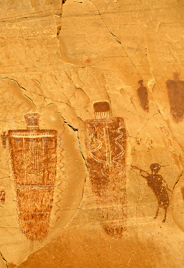 Spear and trumpet man and other pictographs on canyon wall, Horseshoe Canyon Unit, Maze District, Canyonlands National Park, Utah
