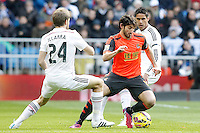 Real Madrid's Asier Illarramendi (l) and Raphael Varane (r) and Real Sociedad's Esteban Granero during La Liga match.January 31,2015. (ALTERPHOTOS/Acero) /NortePhoto<br /> /NortePhoto.com