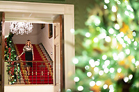 2020 White House Christmas<br /> <br /> First Lady Melania Trump walks down the Grand Staircase of the White House Sunday, Nov. 29, 2020, as she arrives to review the Christmas decorations. (Official White House Photo by Andrea Hanks)