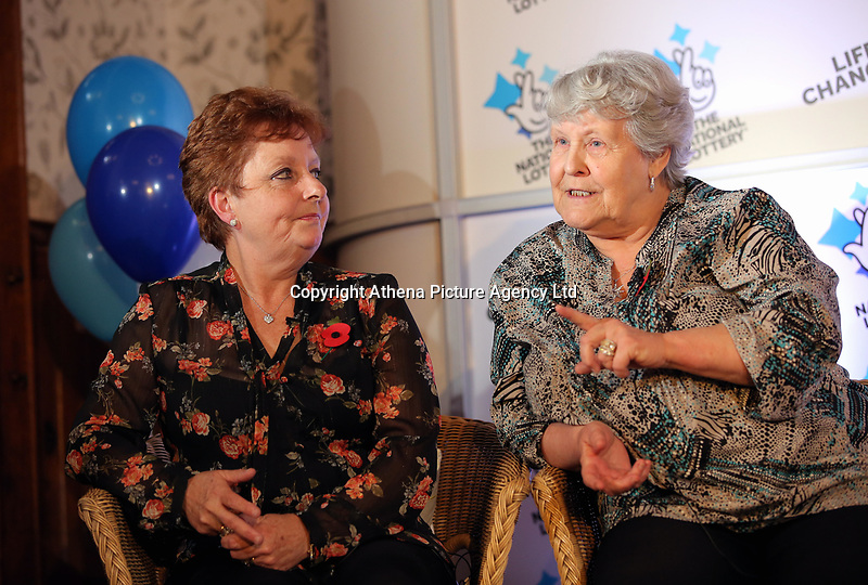 Pictured L-R: Jule Saunders and Jean Cairns. Wednesday 08 November 2017<br />Re: Presentation of hospital catering syndicate win £25m in Euromillions Jackpot at Hensol Castle, south Wales, UK. Julie Saunders, 56, Doreen Thompson, 56, Louise Ward, 37, Jean Cairns, 73, SIan Jones, 54 and Julie Amphlett, 50 all work as catering staff for Neath Port Talbot Hospital in south Wales.