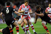 Henry Purdy of Gloucester Rugby finds his way blocked by Ben Toolis and Sam Hidalgo-Clyne of Edinburgh Rugby