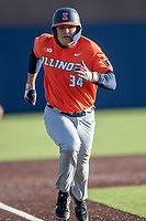 Illinois Fighting Illini catcher Ryan Hampe (34) runs home during the NCAA baseball game against the Michigan Wolverines on March 19, 2021 at Fisher Stadium in Ann Arbor, Michigan. Illinois won the game 7-4. (Andrew Woolley/Four Seam Images)