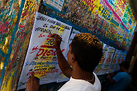 "A Colombian sign painter writes with a brush while working on music party posters in the sign painting workshop in Cartagena, Colombia, 15 April 2018. Hidden in the dark, narrow alleys of Bazurto market, a group of dozen young men gathered around José Corredor (""Runner""), the master painter, produce every day hundreds of hand-painted posters. Although the vast majority of the production is designed for a cheap visual promotion of popular Champeta music parties, held every weekend around the city, Runner and his apprentices also create other graphic design artworks, based on brush lettering technique. Using simple brushes and bright paints, the artisanal workshop keeps the traditional sign painting art alive."