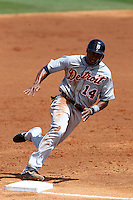 Detroit Tigers outfielder Austin Jackson #14 rounds third during a spring training game against the St Louis Cardinals at Roger Dean Stadium on March 28, 2012 in Jupiter, Florida.  Cardinals defeated the Tigers 9-5.  (Mike Janes/Four Seam Images)