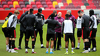 Brentford's Assistant Head Coach, Brian Riemer, chats to the Brentford team ahead of kick-off during Brentford vs Barnsley, Sky Bet EFL Championship Football at the Brentford Community Stadium on 14th February 2021