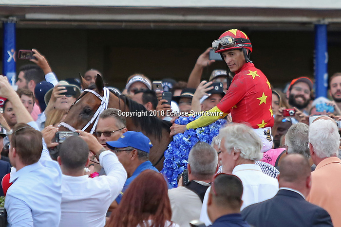 HALLANDALE BEACH, FL - MARCH 31:  Audible #8 with jockey John Velazquez in the winners' circle after winning the Xpressbet Florida Derby GI Stakes. Scenes from Florida Derby Day at Gulfstream Park on March 31, 2018 in Hallandale Beach, Florida. (Photo by Liz Lamont/Eclipse Sportswire/Getty Images)