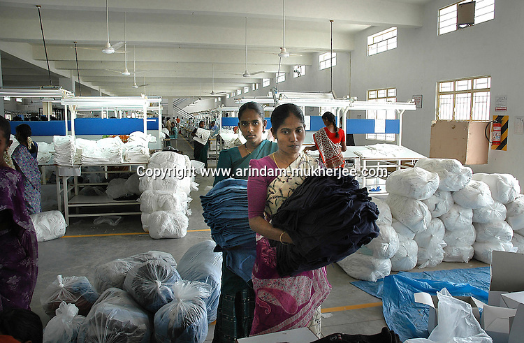 Women working at Popy's garment stitching factory in Tirupur, Tamilnadu. After lifting of quota system in textile export on 1st january 2005. Tirupur has become the biggest foreign currency earning town of India.