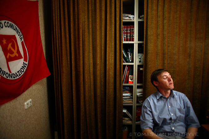 The chief editor of the Communist newspaper of Moldova exhales cigarette smoke inside the editorial offices of the newspaper in Chisinau, Moldova on 28 May 2009.