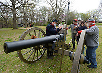 Joe Rainey (from left), Bob Underdown, Jim Spillars, Brenna Drindak and Martin Bradford, all members of the cannon demonstration crew for Prairie Grove Battlefield State Park, work Saturday, April 3, 2021, on how a firing crew accurately and safely fires a Civil War-era Parrott rifle during a day of practice at the park in Prairie Grove. The group is made up of members of the First Arkansas Mountain Artillery and the Seventh Arkansas Field Artillery historical re-enactment groups. Visit nwaonline.com/210404Daily/ for today's photo gallery. <br /> (NWA Democrat-Gazette/Andy Shupe)
