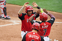 Team USA JP Crawford (3) high fives Tony Kempt (7) after scoring a run during the MLB All-Star Futures Game on July 12, 2015 at Great American Ball Park in Cincinnati, Ohio.  (Mike Janes/Four Seam Images)