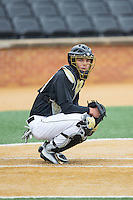 Wake Forest Demon Deacons catcher Nick Bisplinghoff (39) looks to the dugout for the pitch call during the game against the Towson Tigers at Wake Forest Baseball Park on March 1, 2015 in Winston-Salem, North Carolina.  The Demon Deacons defeated the Tigers 15-8.  (Brian Westerholt/Four Seam Images)