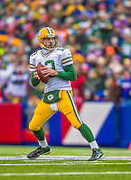 14 December 2014: Green Bay Packers quarterback Aaron Rodgers looks downfield for an open receiver in the second quarter against the Buffalo Bills at Ralph Wilson Stadium in Orchard Park, NY. The Bills defeated the Packers 21-13, snapping the Packers' 5-game winning streak and keeping the Bills' 2014 playoff hopes alive. Mandatory Credit: Ed Wolfstein Photo *** RAW (NEF) Image File Available ***