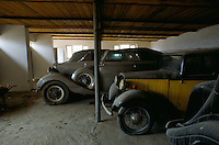 From the right to the end, the back of the Jaguar, the black&yellow Ford, the Rolls Royce Phantom III and the drop-head Daimler DK400 in the bunker build by UNESCO in the courtyard of the Afghan Kabul National museum in 1991