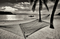 Hammock and sunset at Bolongo Bay Beach. St. Thomas. US Virgin Islands.