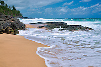 Waves and beach. Secret Beach, Kauai, Hawaii.