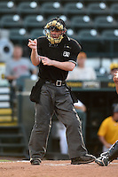 Umpire Scott Costello makes a call during a game between the Jupiter Hammerheads and Bradenton Marauders on June 25, 2014 at McKechnie Field in Bradenton, Florida.  Bradenton defeated Jupiter 11-0.  (Mike Janes/Four Seam Images)