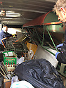 """13/03/15<br /> <br /> **Collect Photo - Best Quality Available**<br /> <br /> Colin Temple-Smith (right) loads parts from four Tiger Moths discovered in Belgiun barn into a van.<br /> <br /> ***FULL STORY HERE:   http://www.fstoppress.com/articles/tiger-moth-restorations/    ****<br /> <br /> You may remember spending hours toiling over Airfix models, painstakingly following intricate instructions and trying not to glue your fingers together before painting your own miniature version of one of the RAF's or Luftwaffe's finest aircraft. Then spare a thought for one man who has just helped to restore and put together one World War Two Tiger Moth and is about to start piecing together another FOUR aircraft that were discovered in bits in a barn.<br /> <br /> Sixty-year-old Colin Temple-Smith – who wears a moustache that any Wing Commander would be proud of – has spent a lifetime restoring vintage cars and motorcycles and recently quit his job as a window fitter to help re-build the five bi-planes that will become part of a growing fleet of Tiger Moths at Derbyshire based Blue Eye Aviation.<br /> <br /> Today saw the first of the fully-restored five aircraft take to the skies.<br /> <br /> """"It's just like working on old bikes and cars, although they're a lot more fragile"""" explained Colin, whose wife runs the Aviators Café at Darley Moor Airfield near Ashbourne.<br /> <br /> """"When I was a teenager I used to be a member of a modelling club, making flying models from wood and canvas. They're very similar to build – it's really just the size that's changed with these.<br /> <br /> All Rights Reserved: F Stop Press Ltd. +44(0)1335 418629   www.fstoppress.com."""