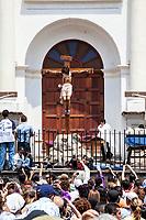 Antigua, Guatemala.  Effigy of Jesus Crucified, in front of San Jose Cathedral, Semana Santa, Good Friday.