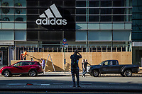 NEW YORK, NEW YORK - JUNE 1: An Adidas store is boarded up on June 1, 2020 in New York. The protests spread across the country in at least 30 cities across the United States, over the death of unarmed black man George Floyd at the hands of a police officer, this is the latest death in a series of police deaths of black Americans. Today is the first night of a curfew in New York City (Photo by Pablo Monsalve / VIEWpress via Getty Images)