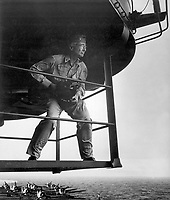 Edward J. Steichen, photographic expert, on island platform, studies his surrounding for one of his outstanding photographs of life aboard an aircraft carrier.  Steichen held the rank of Comdr. at this time. Ca.  Attributed to Lt. Victor Jorgensen. (Navy)<br /> Exact Date Shot Unknown<br /> NARA FILE #:  080-G-324556<br /> WAR & CONFLICT #:  759