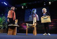 Saturday 24 May 2014, Hay on Wye UK<br /> Pictured: Jennifer Saunders (R) holding a Claridge Nursing Home bag on stage with Francine Stock (L).<br /> Re: The Telegraph Hay Festival, Hay on Wye, Powys, Wales UK.