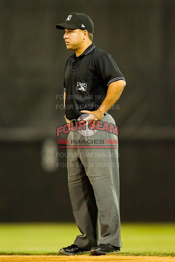 Umpire Ivan Mercado handles the calls on the bases during the South Atlantic League game between the Augusta GreenJackets and the Hickory Crawdads at L.P. Frans Stadium on April 29, 2011 in Hickory, North Carolina.   Photo by Brian Westerholt / Four Seam Images