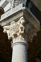 Picture and image of the Tuscan Romanesque Pisan style basilica of Santissima Trinita di Saccargia, historicated pillar capitals, consecrated 1116, Codrongianos, Sardinia.