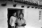 Isle of Man, 1970s. Mother and daughter living in a traditional stone thatched Long House. 1978.