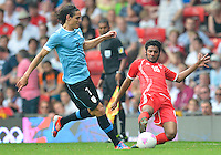 July 26, 2012..Uruguay's Edinson Cavani (7) and UAE's Rashed Eisa (16).UAE vs Uruguay Football match during 2012 Olympic Games at Old Trafford in Manchester, England. Uruguay defeat United Arab Emirates 2-1...