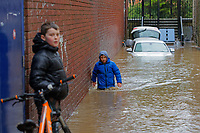 Pictured: A young boy enters a flooded lane in Pontypridd, Wales, UK. Sunday 16 February 2020<br /> Re: Storm Dennis has been affecting parts of Wales, UK.