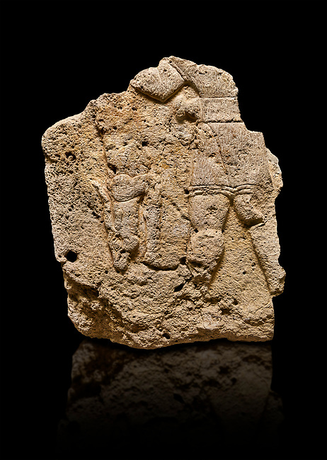Hittite relief sculpted orthostat stone panel of Long Wall Limestone, Karkamıs, (Kargamıs), Carchemish (Karkemish), 900 - 700 B.C. Anatolian Civilizations Museum, Ankara, Turkey. The short-skirted figure with a dagger at the waist holds the gazelle from its hind legs.<br /> <br /> On a black background.